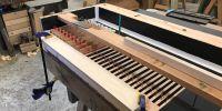 Gt soundboard being reassembled