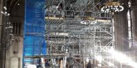 The huge scaffolding required to facilitate safe access to all parts of the casework, and to lift out the heavy internal components.